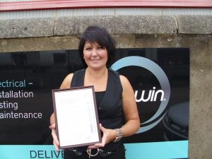 Health, Safety and Environmental Manager, Bronagh McGarrity receiving the SafeContractor Certification
